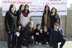 Students from the Evangelical Lutheran School of Hope in Ramallah around the new cornerstone.