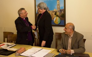 Bishop Munib Younan shakes hands with Bishop Susan Johnson