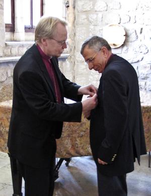 Archbishop Kari Makinen bestows the St. Henrik Cross on Bishop Munib Younan April 5, 2011