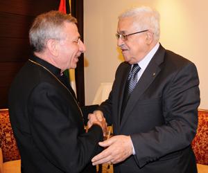 President Abbas and Bishop Younan Shake Hands