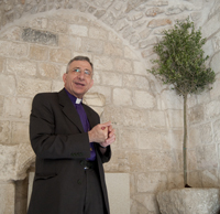 Bishop Younan plants a tree in Wittenberg and in Jerusalem