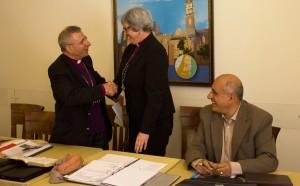 Bishop Munib Younan shakes hands with Bishop Susan Johnson