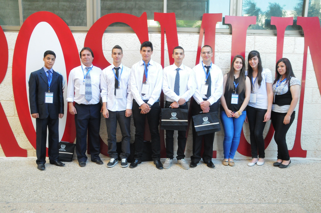 Students from the Model United Nations teams from Beit Sahour, Beit Jala, and Ramallah pose for a photo.