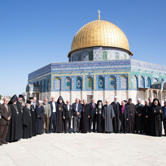 Christian and Islamic leaders in Jerusalem pose for a group photo in front of the Dome of the Rock.