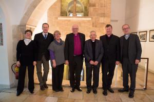 Presiding Bishop of the Evangelical Lutheran Church of Norde Kirche (VELKD), Bishop Gerhard Ulrich, and his delegation pose with ELCJHL Bishop Munib Younan. (© D. Hudson/ELCJHL)
