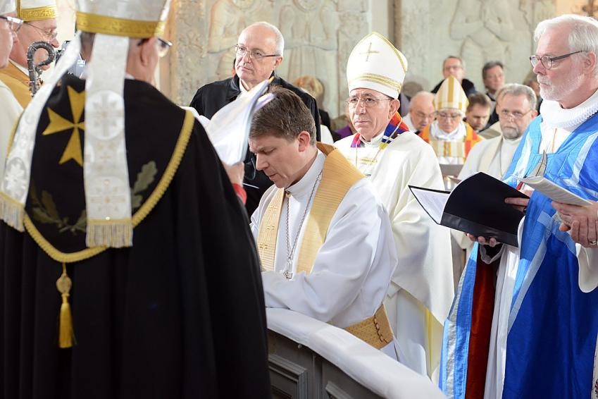 LWF President Bishop Dr Munib A. Younan and other church leaders during the consecration of Estonian Lutheran Archbishop Urmas Viilma (kneeling) at St Mary's Cathedral in Tallinn. Photo: Erik Peinar